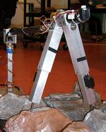 Compass Gait Robot Locomotion in Rough Terrain